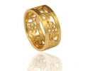Two 14K gold bands with flowers in between
