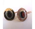 Vintage gold earrings with a beautiful garnet stone
