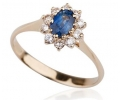Gold vintage ring with sapphire trimmed in diamonds side view