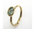 Vintage style yellow gold ring with a blue topaz stone.