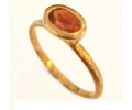 Vintage style yellow gold ring with a garnet stone.