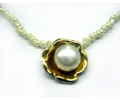 Vintage Style Pearl Necklace Featuring a Gold Ornamented Pearl Pendant